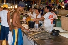 Click to see details of Vendors sorting and selling fish