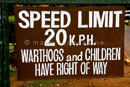 Warthog and children right of way sign