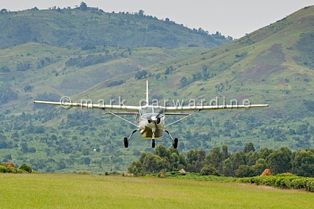 Tourists arriving by plane at Bwindi airstrip, Bwindi Impenetrab